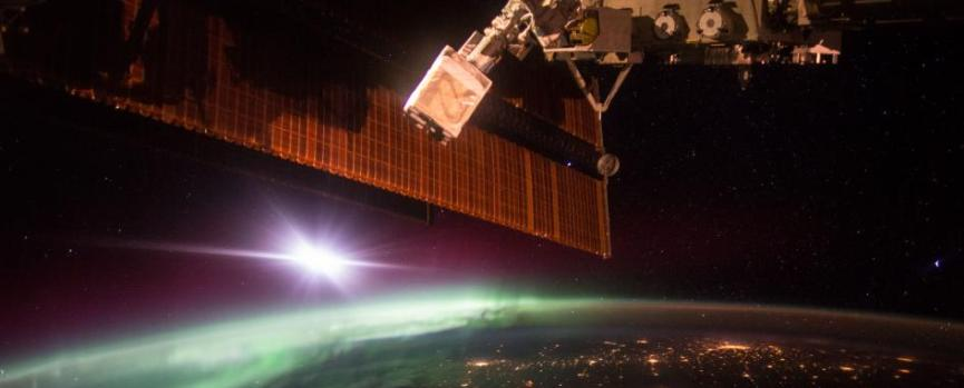 Astronaut Scott Kelly snapped this shot of the aurora borealis while aboard the International Space Station. The largest cluster of lights in view is North Dakota's Bakken shale formation.jpg