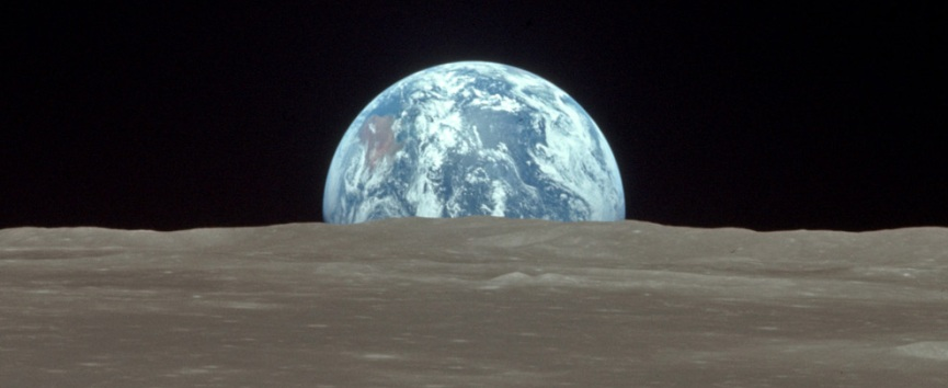 The view from the Apollo 11 Command and Service Module (CSM) Columbia shows the Earth rising above the Moon's horizon on July 20th 1969.jpg